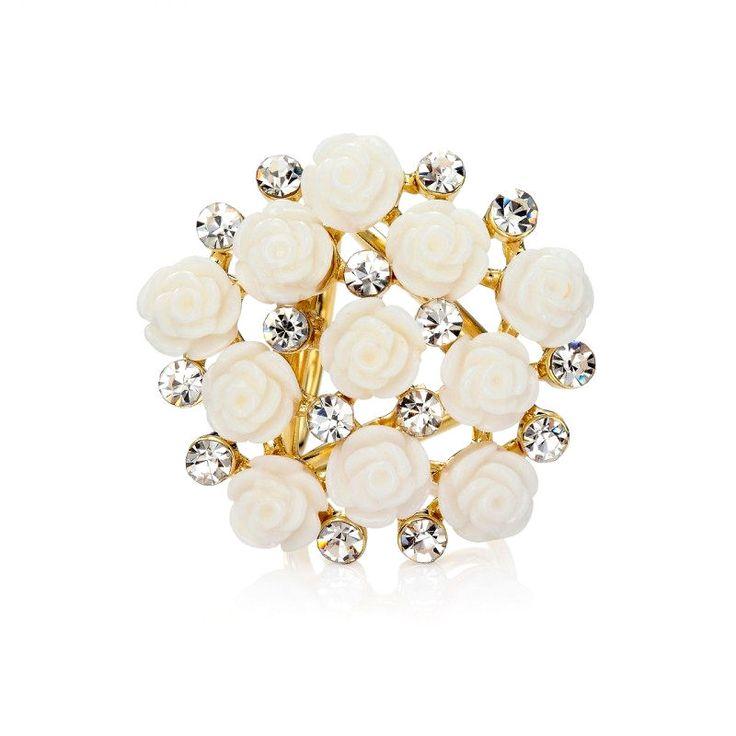 Kytica kvetov je prstencová ozdoba na hodvábne šály a šatky. Ozdobu tvoria kryštály spojené s množstvom kvetov ruží. Ozdoba obsahuje zadné prstence, slúžiace na prevlečenie hodvábnej šatky alebo šálu. Prstenec je druh spony na šatky, ktorý obsahuje trojitý krúžok na prevliakanie šatiek a šálov. Skúste byť originálna a ozdobne si svoju hodvábnu šatku alebo hodvábny šál. Ozdoba je ideálny doplnok používaný pre držanie šatky alebo šálu na krku.