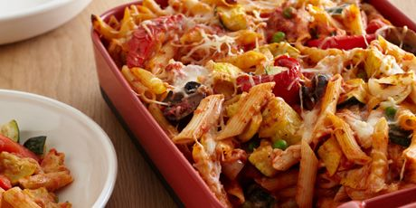 Roasted peppers, zucchini, summer squash and cremini mushrooms baked in a dish with penne, cheese and tomato sauce.