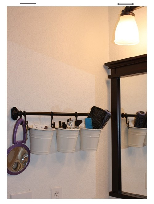 Need extra storage space in your bathroom?  This IKEA towel rack and canisters are a simple and inexpensive way to add storage and get everything off your counter for a lovely staged look!  I already have the towel bar!