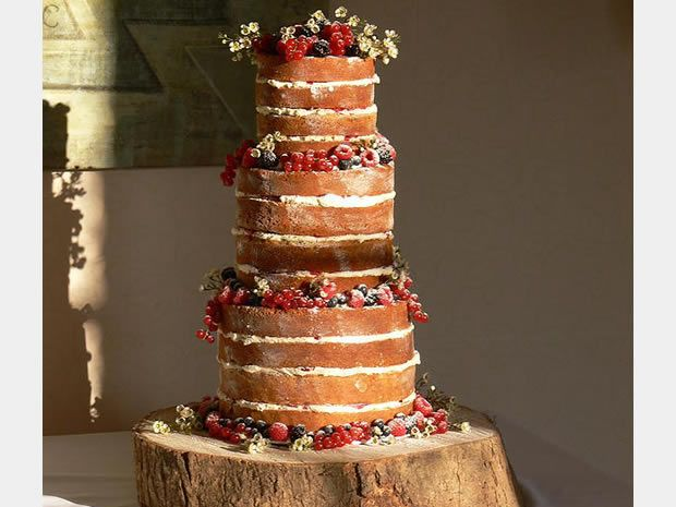 This show-stopping masterpiece can be found at Cherish Cakes in Wotton-under-Edge. #weddingcakes #nakedcakes #rusticwedding