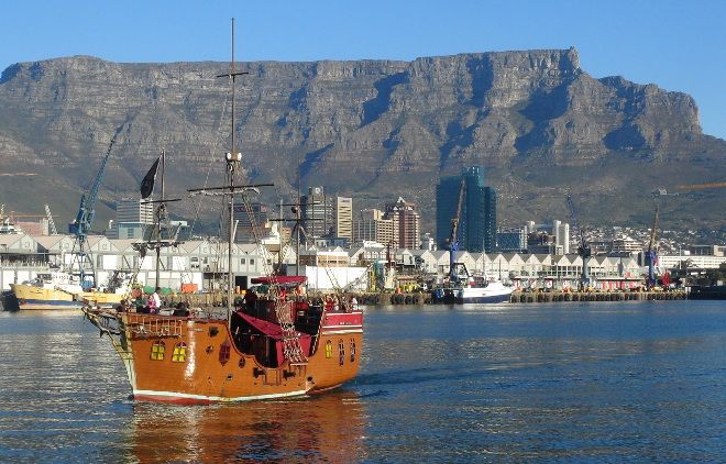 Jolly Roger pirate ship with Table Mountain in the background