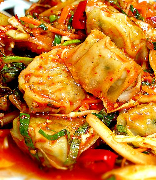 BIBIM MANDOO (Tossed Dumplings): Korean steamed water dumplings (soft, tiny dumplings made to be served wet) are tossed around with vegetables in a tangy, spicy, and sweet sauce.