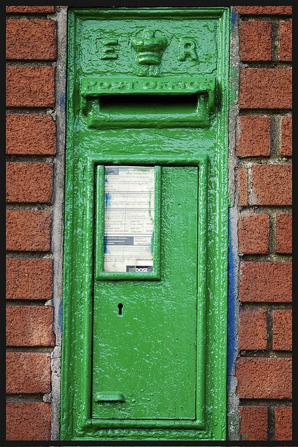 Irish letterbox - But do you notice how the letters ER (Edward Regina) are still on it - eventhough we won our Independence from England in 1921! These postboxes were originally red - we painted them green. You could call it an Irish answer to an Irish problem.