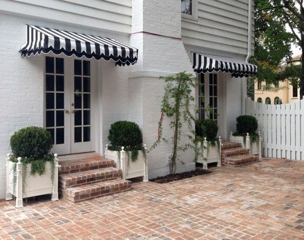 Love the black and white awnings, such great inspiration for designing a room around
