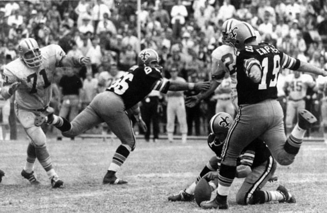 1963 - Saints' kicker Tom Dempsey kicks a then-record 63 yard field goal. Dempsey was born with only half a foot