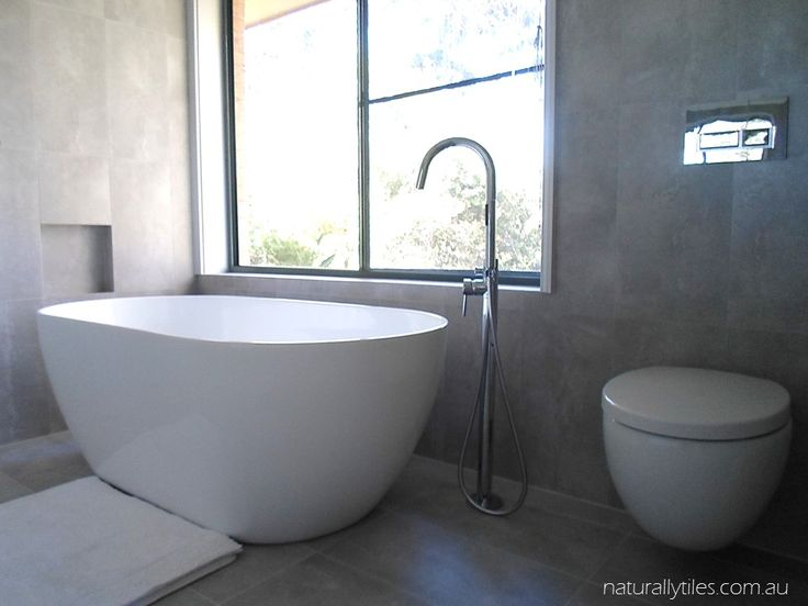 Meares home Positano Freestanding bath and a Parisi wall hung toilet.  All designed & supplied by naturallytiles.com.au, with our designer Nicole Chabaki
