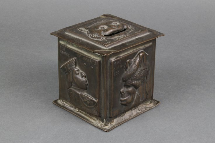 """Lot 213, Sy Schreckinger, a late 19th Century square embossed copper money box decorated figures from Alice in Wonderland with sliding base, marked Prov.Pat 18808/07, 4""""h sold for £150"""