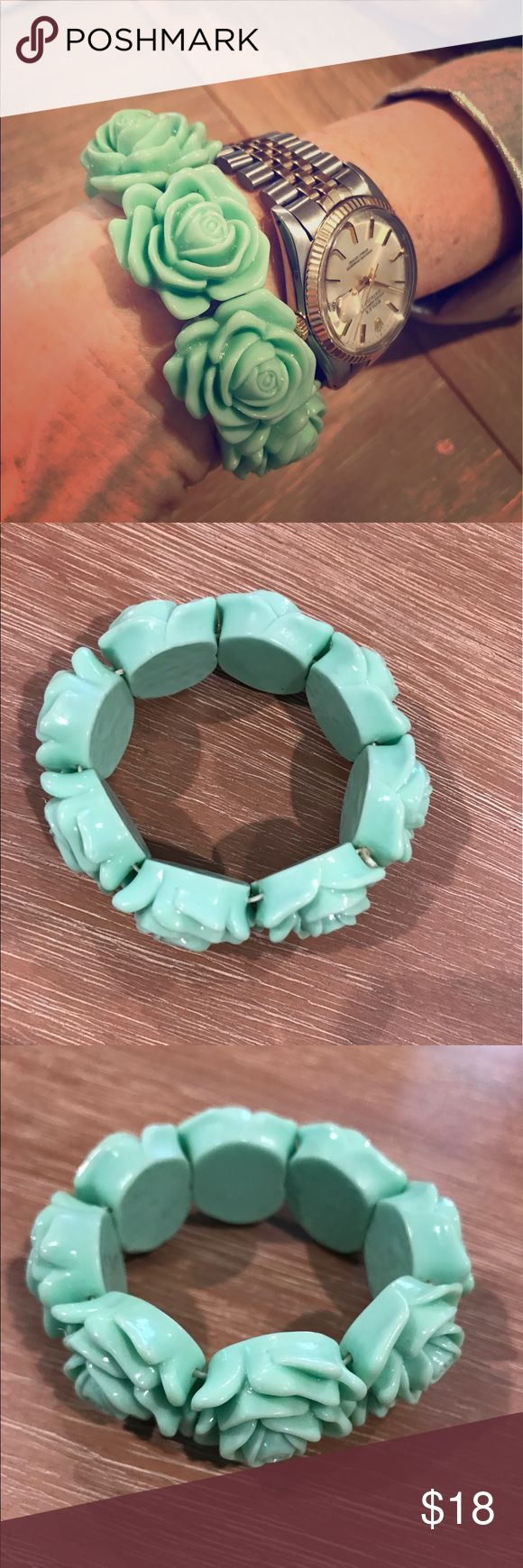Teal flowered bracelet BOUTIQUE 🔹one size fits all🔹plastic rosettes make up this fun little stretchy piece for your wrist!! Purchased with a few dresses one day, at a local Beverly Hills boutique! boutique Jewelry Bracelets