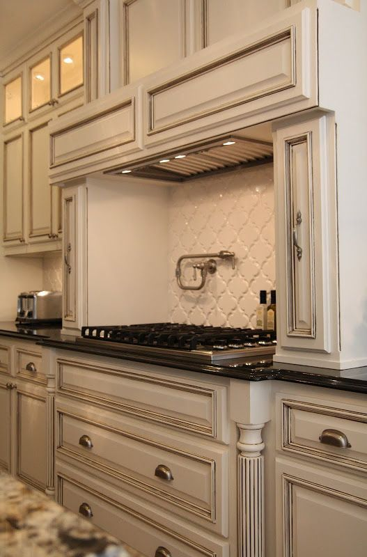 cabinet color and pot filler  paint is benjamin moore   white dove   with a chocolate glaze  live beautifully  before  u0026 after   arabesque love best 25  antique kitchen cabinets ideas on pinterest   antiqued      rh   pinterest com