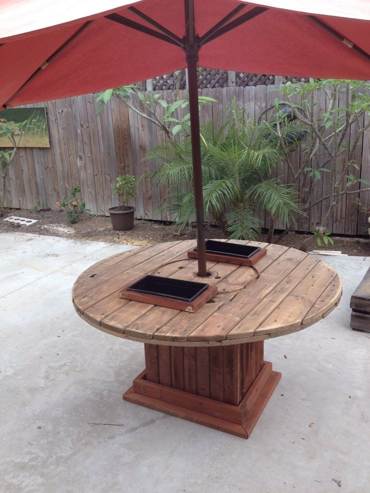 Repurposed cable spool top into a crawfish table beer for Wooden cable reel ideas