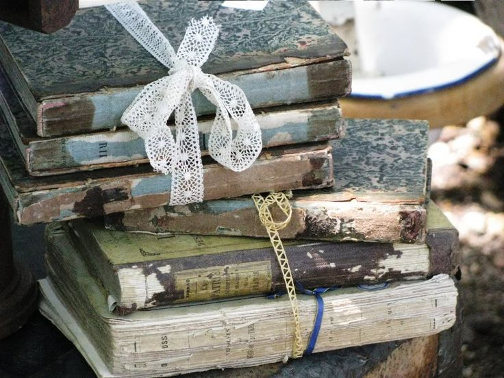 Vintage books as decor for an antiquarian librarian themed wedding