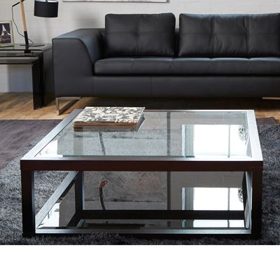 The contrast between the clear and black glass on this table, are brought together by a strong darkwood frame. A classic design which will be timeless in your lounge.