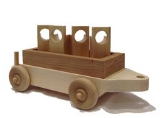 """The flat car carries four wooden cargo designed to be easily captured and lifted by the crane and is designed to follow our Crane Car down the line. The flat car is 12"""" long x 4"""" wide."""