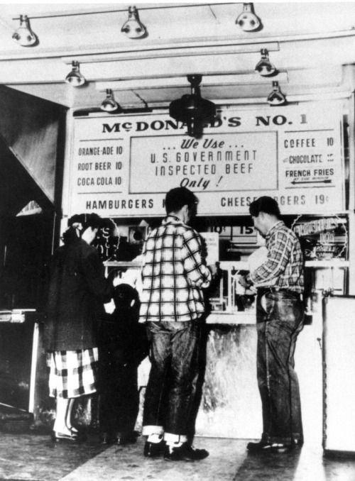 """Customers line up outside the first McDonald's hamburger stand which was opened in 1948 by brothers Dick and Maurice McDonald in San Bernadino, California - [[MORE]]namraka:The McDonalds migrated from Manchester, New Hampshire to Hollywood in the late 1920s, where brothers Richard and Maurice McDonald began working as set movers and handymen at motion-picture studios. In 1937, their father Patrick McDonald opened """"The Airdrome"""", a food stand, on Huntington Drive (Route 66) ..."""