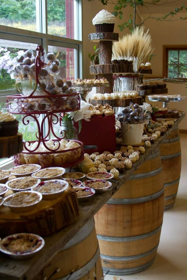 Logs to give height for buffet. Love the table sitting on the barrels. At Vintage Emporium rentals our barrels nearly always get booked out and used in lots of applications. This dessert table looks great.