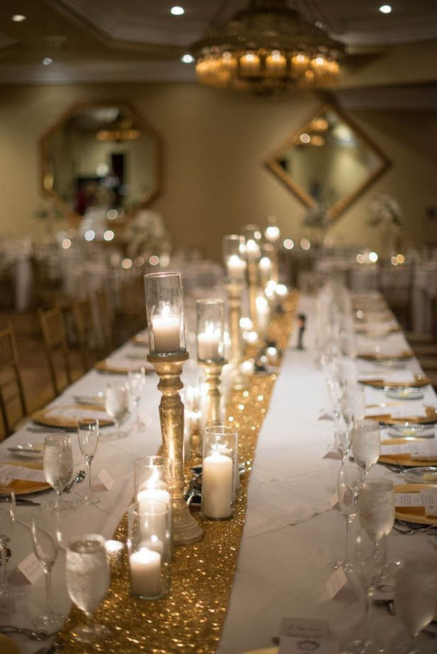 Candles on gold candle stands and gold glitter table runner at Casa Monica Hotel wedding in Florida