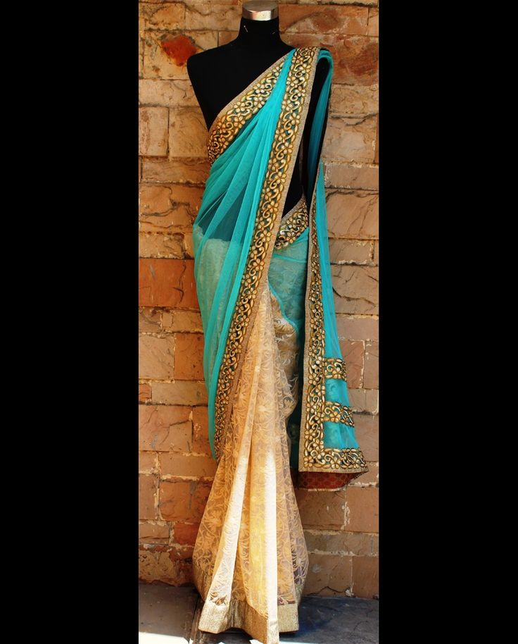 Cream and sky blue embroidered sari 1. Cream and sky blue net embroidered sari 2. It has sky blue net pallu with golden color border 3. Intricated with zari work,floral and lace work 4. Comes with an unstitched blouse piece