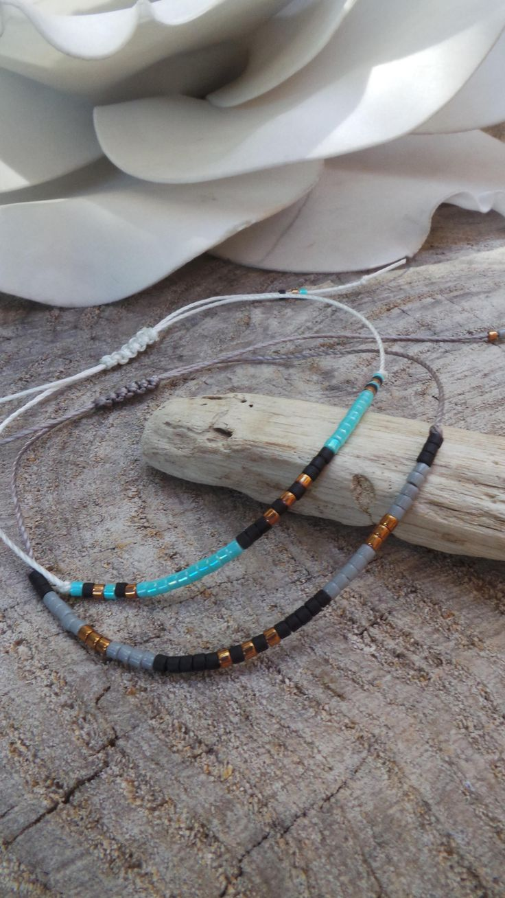 This  minimalist little bracelet is so beautiful and delicate!  *Made with a tiny Miyuki delica seed beads on a simple waxed cord. *Choose between the  turquoise or grey combination. •Size: It closes with a macrame weave making it adjustable so it will fit all sizes.  • To adjust the fit just p