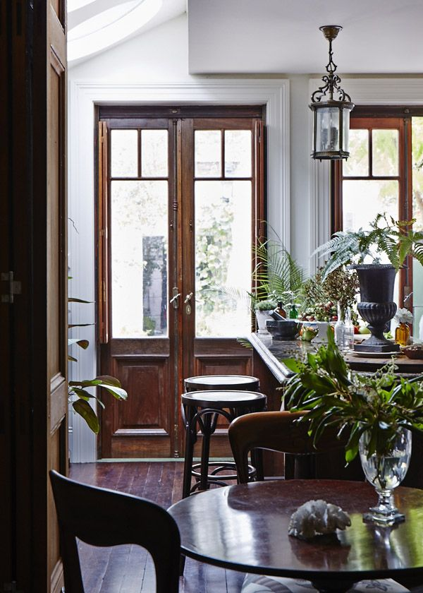 Tall antique french doors, wood floor, sitting area in kitchen