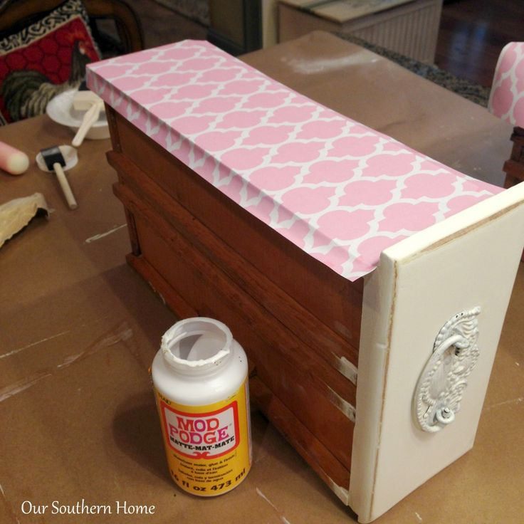 line up paper straight on drawer front edge,use a roller instead of credit card to get out the bubbles, let dry, use straight edge to tear paper after dried...no measuring