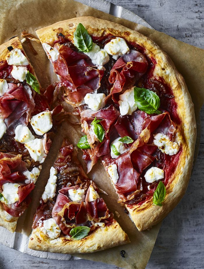 Loaded with goats' cheese and parma ham, this pizza will make your Friday night.