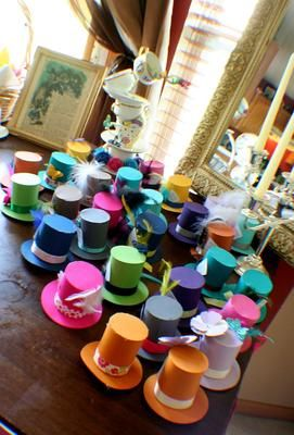 Alice in Wonderland Mad Tea Party Baby Shower - top hat fascinators: Alice in Wonderland Mad Tea Party Baby Shower The theme was everything Alice, but it had to be mad! Our shower journey began with the invitations which