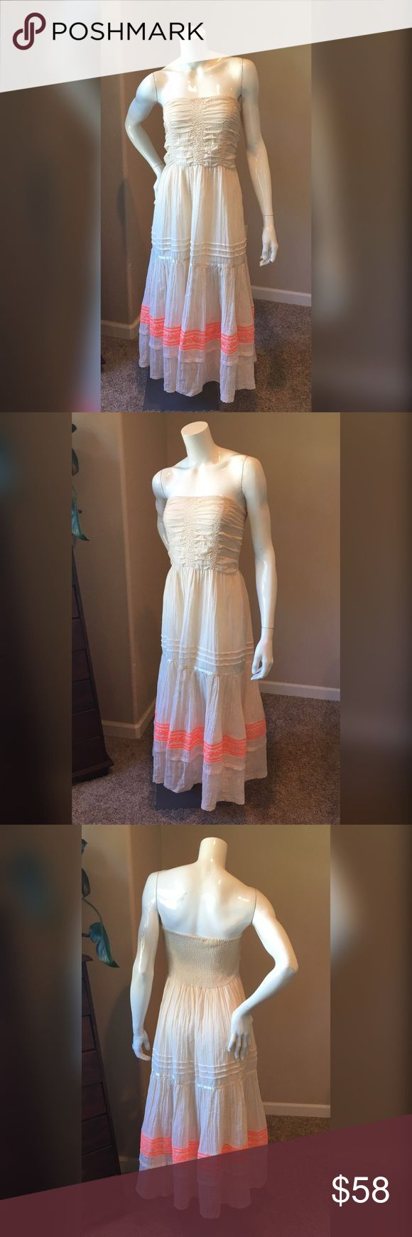 Free People S boHo strapless embroidered dress Free People S boHo strapless embroidered dress. All the stress is so small I would say that's a medium large best. Beautiful cream soft beige smocked top dress. Neon orange embroidering on the hem. This dress sits at midi length. Measurements will be posted soon Free People Dresses Midi