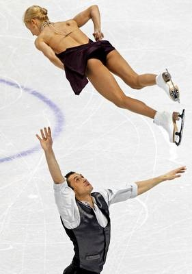 It's a toss-up Tatiana Volosozhar (top) and Maxim Trankov of Russia skate in the pairs short program during the ISU World Figure Skating Championships at Budweiser Gardens on March 13 in London, Ontario, Canada.