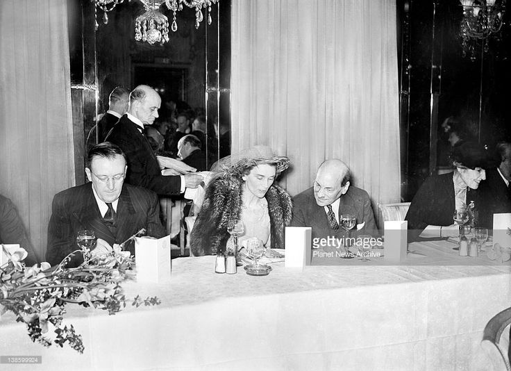 Duchess of Gloucester chatting with Britain's Prime Minister, Hon.Clement Attlee at the Australia Club Luncheon at the Dorcester Hotel, London.'