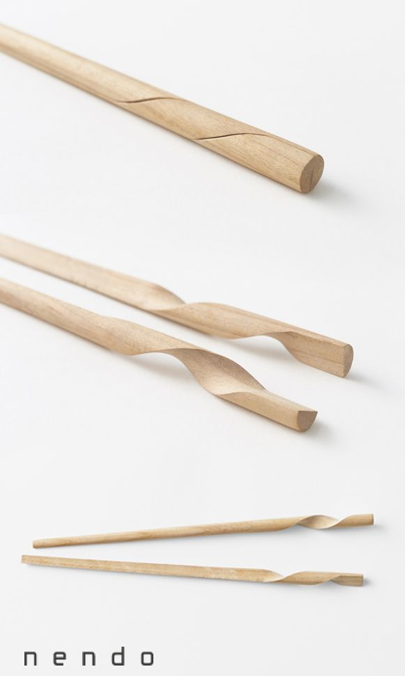 Rassen chopsticks: a single unit that separates into two for eating. Created using artisans' hand skills and a multi-axis CNC mill to achieve the twisting form. | Designed by N. Meister in collaboration with Hashikura Matsukan, a manufacturer in Obama, Fukui Prefecture, Japan | 2013 all rights reserved by nendo inc | photos by Akihiro Yoshida | http://www.nendo.jp/