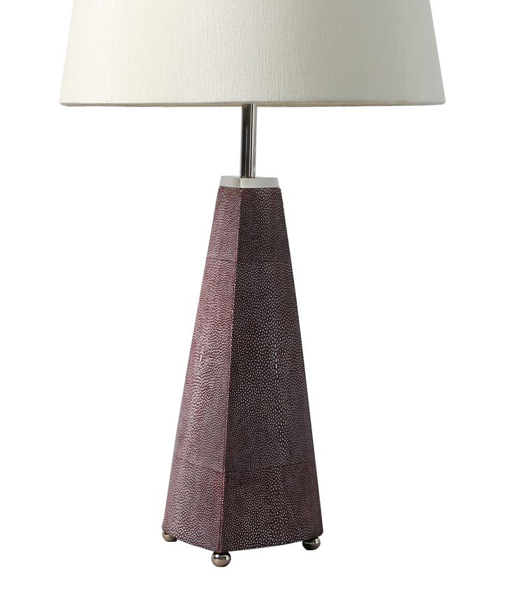 A simple but elegant table lamp / bedside lamp made with stainless steel and faux mulberry shagreen. This beautifully crafted modern lamp comes with a light cream conical silk shade.