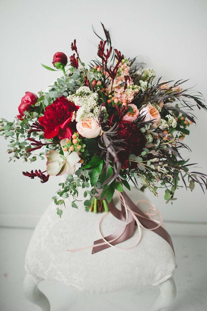 "Bouquet by Fache Floral Designs in Winnipeg From the florist: ""I was inspired by the organic textures of nature, paired with the bold jewel tones in fashion. This style of bouquet would suit a bohemian-chic bride having a wedding that has both whimsical, playful elements, as well as fashion-forward choices that add dreamy and dramatic textures and tones."" Flowers: Ruby-red peonies, peach David Austin garden roses, red kangaroo paws, coral hypericum berries, blush stock, purple ..."