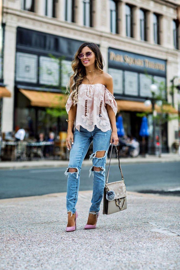 fashion blogger mia mia mine wearing a pink lace top and chloe faye bag