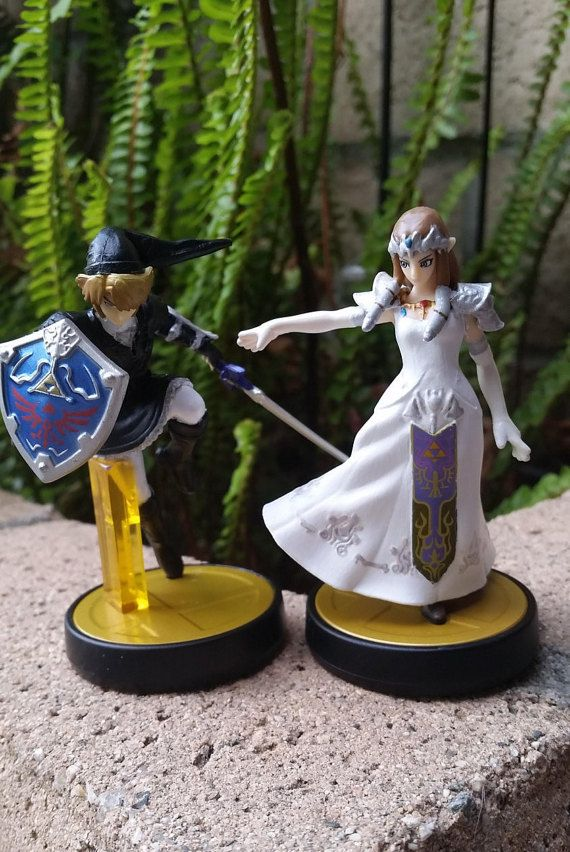 Link joins Zelda for a great gamer wedding cake topper pair. Geek weddings or receptions or bridal showers or engagement parties...I could go on! Lots of great uses for these Legend of Zelda video game wedding themed custom amiibo!