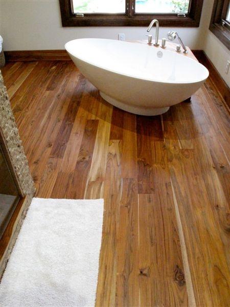 Beautiful Teak bathroom floor with lumber by Proteak.