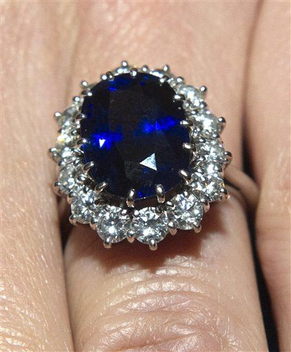 Princess Diana's ring of a sapphire surrounded by diamonds, given to Kate by Prince William.