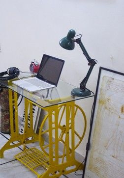 Score! So excited to find an example of exactly how I want to repurpose my old cast iron sewing machine stand - from the yellow paint to the tempered glass top.