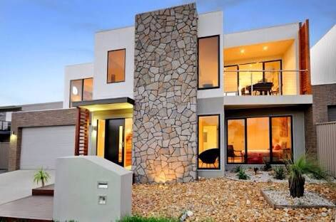 A large fieldstone feature wall adds a proportion of texture relative to the size of this house.