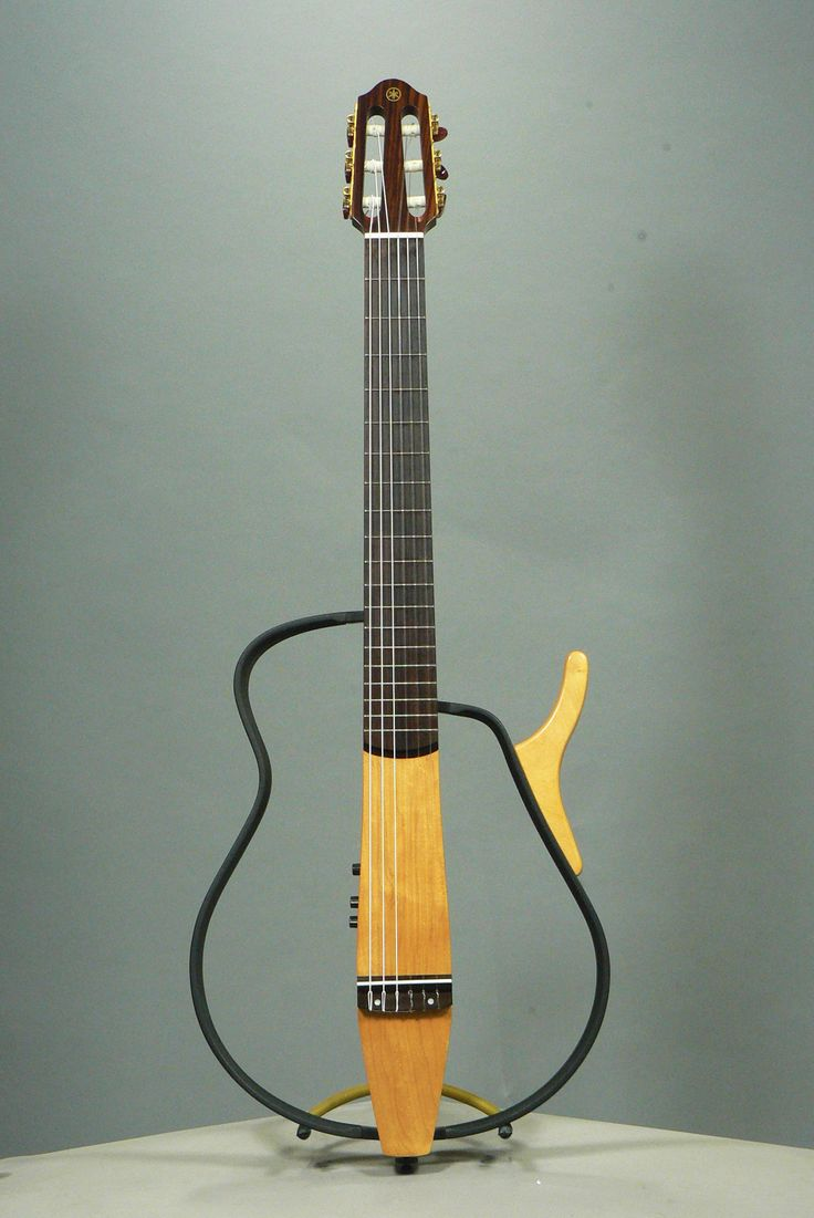 Yamaha came up with a new line of guitar called Silent Guitars in the early 2000s. Basically electro-acoustics with a headphone jack, the SLG are available with nylon strings (SLG-100N) or steel strings (SLG-100S). Yamaha also included a set of FX controls: Two reverbs, a chorus and a delay. The Silent Guitar has been designed with travelling guitarists in mind, as the frame can be dismantled easily.