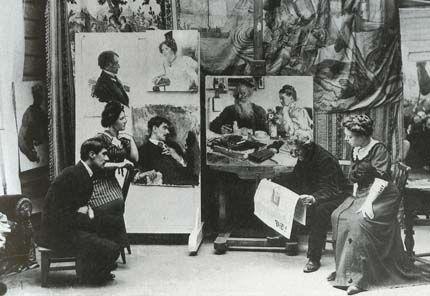 Чуковский (сидит слева) в студии Ильи Репина, Куоккала, ноябрь 1910 года. Репин читает сообщение о смерти Толстого. На стене виден неоконченный портрет Чуковского. Фотография Карла Буллы.