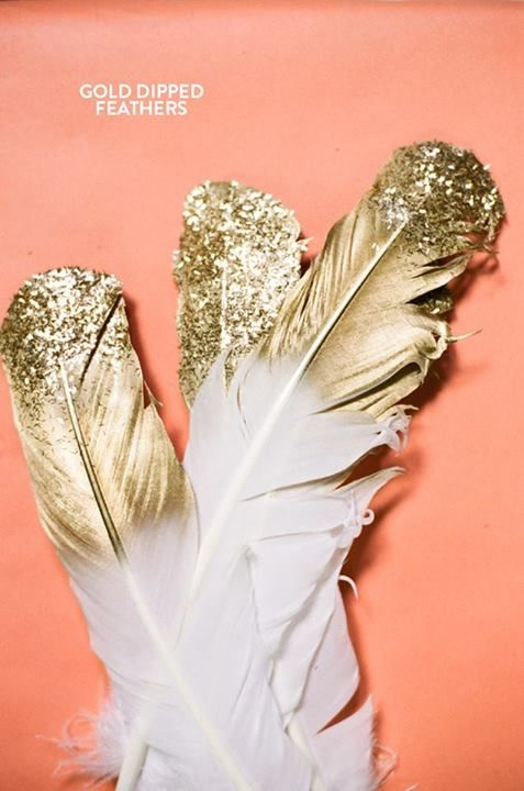 Gold-dipped feathers -- display in a vase