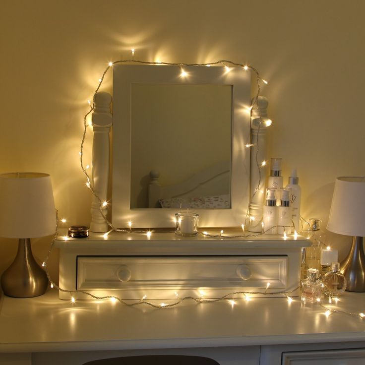 Pretty warm bedroom fairylights around a dresser ideas - String lights for bedroom ...