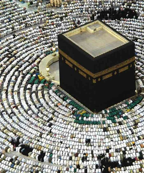The men in green are the janitorial staff of the Haram - look how close they get to the Ka'bah!