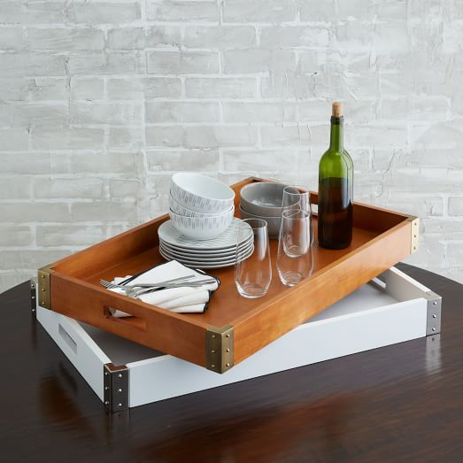 The Mid-Century Tray is crafted of rich wood with studded metal details at the edges. Use it on its own or mix and match with our other wood and acrylic trays.