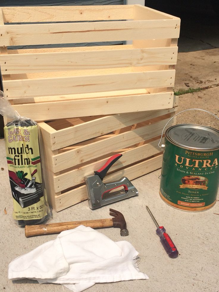 DIY Planter Box: pre-made wooden crates from Menards. After staining the crates, line each crate w/ landscaping plastic. Add a little rock to the bottom. Then add dirt and flowers. I poked some pin holes along the bottom gap btwn the boards to allow excess water to drain if need be