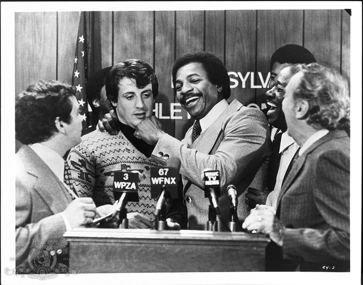 Still of Sylvester Stallone and Carl Weathers in Rocky (1976) http://www.movpins.com/dHQwMDc1MTQ4/rocky-(1976)/still-994083840