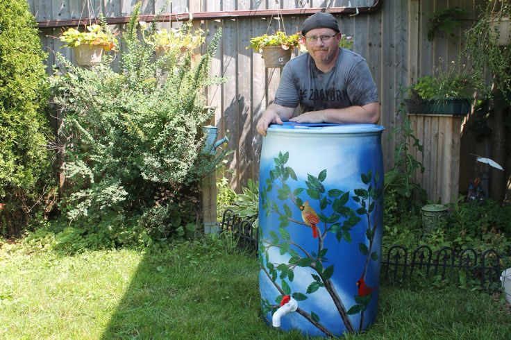"""-FOR SALE- Rain barrel #002 """"The Cardinal's Tree"""" Photo #3 of 4  Complete with 5' of overflow tubbing, colored cleanable aquarium gravel filter system & all hardware parts are replaceable. One of a kind, hand painted with Krylon Fusion paint for plastic."""