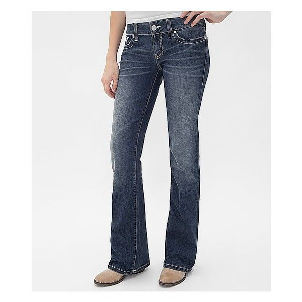 """Low rise zip fly stretch jean. Wide waistband. Slim through the hip and thigh. Slightly flared 19"""" bottom opening. Embroidery on pieced back pockets. Hand sand…"""