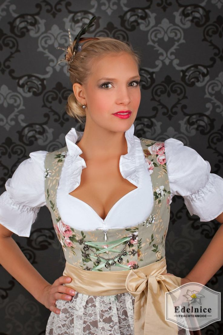 Dirndl | S♥ This is my favorite style of dirndl, with the primary color towards canvas, khaki, to palest green, and accented with pink roses. One of the first I ever pinned was of this sort, but wasn't modeled. I deeply wished to see it on a woman vice a mannequin.