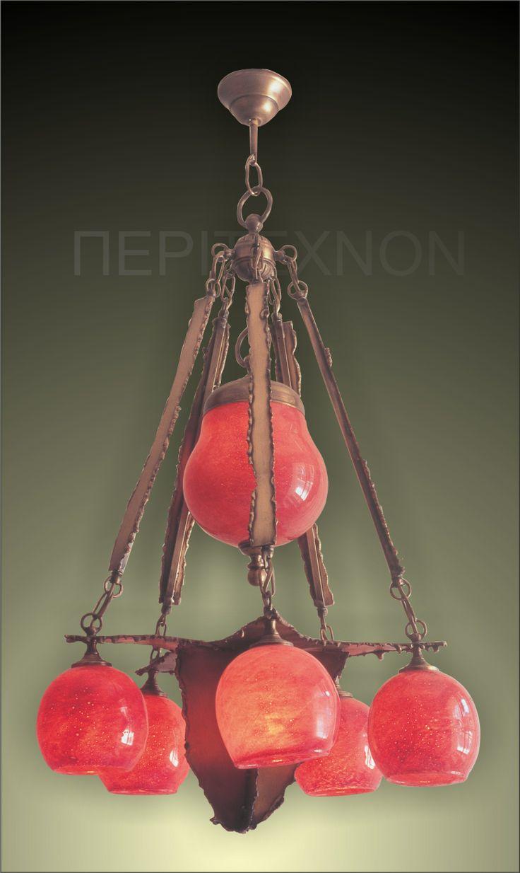 Ένα φωτιστικό με 5+1 φωτα.Μία μοναδική δημιουργία του Βασίλη Αθανασόπουλου από οξειδωμένο μπρούτζο και φυσητό γυαλί. http://peritexnon.weebly.com/